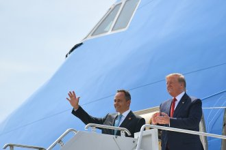 President Trump has been campaigning for Kentucky Republican Gov. Matt Bevin (left), who is on the ballot for reelection Tuesday. Above, they step off Air Force One in August at Louisville, Ky.'s airport.