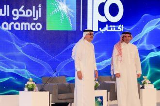 President and CEO of Saudi Aramco Amin Nasser and company chairman Yasir al-Rumayyan at a press conference in Dhahran, Saudi Arabia on Sunday. The privately-owned oil giant announced it will IPO next month.