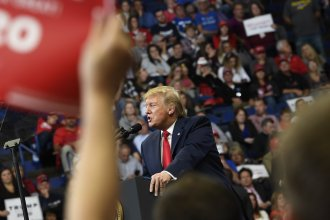 President Trump speaks during a campaign rally in Lexington, Ky., Monday. His efforts don't appear to have been enough to carry incumbent GOP Gov. Matt Bevin over the finish line.