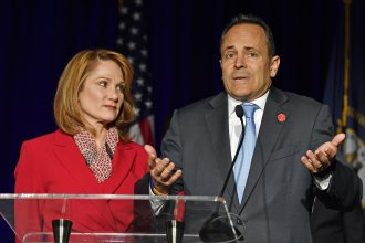 Kentucky Gov. Matt Bevin, with his wife, Glenna, speaks to supporters gathered at the Republican Party celebration event in Louisville, Ky., on Tuesday. Bevin has requested a recanvassing of the gubernatorial election's results.