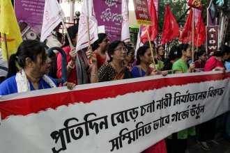 Activists demanding justice in the case of a veterinarian who was gang-raped and killed last week shout slogans during a protest on Thursday in Kolkata, India.