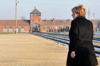 German Chancellor Angela Merkel walks toward the main railway entrance to Birkenau, the largest of the camps that made up the Auschwitz complex in Poland. It was the German chancellor's first visit to the former Nazi death camp, an enduring symbol of the Holocaust, since taking office 14 years ago.