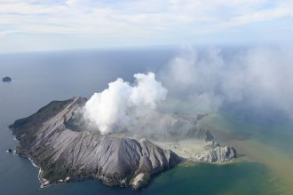 Smoke billows from White Island after a volcanic eruption on Monday. Officials say some remain unaccounted for, and it remains too dangerous for emergency services to access White Island.