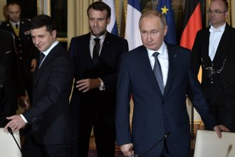 Ukrainian President Volodymyr Zelenskiy, French President Emmanuel Macron and Russian President Vladimir Putin arrive for a meeting on Ukraine with German Chancellor at the Elysee Palace on Monday in Paris.