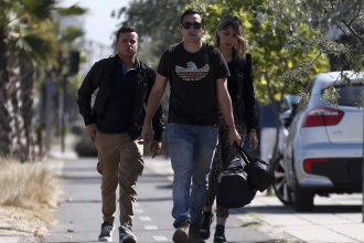 Relatives of passengers of a missing military plane arrive to the Cerrillos airbase in Santiago, Chile, on Tuesday.