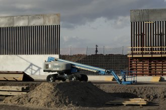 The first panels of levee border wall are seen at a construction site along the U.S.-Mexico border last month in Donna, Texas. The new section, with 18-foot-tall steel bollards atop a concrete wall, will stretch approximately 8 miles.