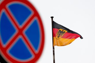 The German flag is seen outside the Embassy in Moscow, where Russia's Foreign Ministry announced Thursday the expulsion of two German diplomats.