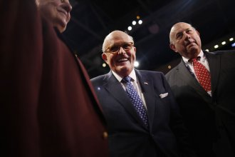 Rudy Giuliani, former mayor of New York, smiles during the Republican National Convention in Cleveland on July 18, 2016.