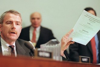Rep. Tom Barrett, D-Wis., holds a draft copy of the Articles of Impeachment against President Clinton in December 1998.