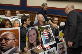 At Wednesday's hearing, Dickson greets relatives and friends of people killed in 737 Max crashes.
