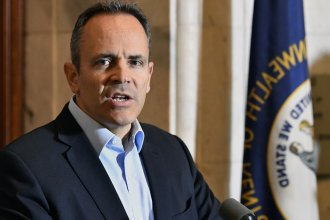 Outgoing Kentucky Gov. Matt Bevin pardoned or commuted the sentences of more than 400 people in his final days in office.