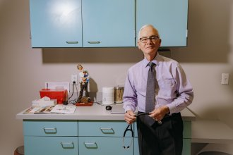 Dr. John Dunlap runs a direct primary care practice in Overland Park, Kan., offering patients direct access to him by phone, and longer appointment times. The model is similar to concierge medicine.