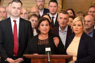 Sinn Fein leader Mary Lou McDonald's party has agreed to a new power-sharing deal with the Democratic Unionist Party. McDonald (center) spoke about the agreement Friday, flanked by deputy leader Michelle O'Neill.