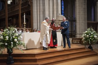 The Rev. Randolph Hollerith, dean of the Washington National Cathedral (from left); the Rev. Carl Wright, the Episcopal Church's bishop suffragan for the armed forces; and Maj. Gen. Steven Schaick, the Air Force chief of chaplains, participate in the blessing of a Bible for swearing in U.S. Space Force officials.