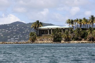 A view of Jeffrey Epstein's stone mansion on Little St. James Island. Prosecutors in the Virgin Islands on Tuesday filed a civil lawsuit that accuses Epstein of human trafficking that victimized young women and children as young as 11 years old. Some of the alleged activity happened as recent as 2018.