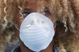 Levi Draheim, 11, wears a dust mask as he participates in a demonstration in Miami in July 2019. A lawsuit file by him and other young people urging action against climate change was thrown out by a federal appeals court Friday.