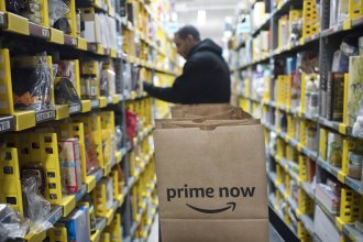 """A clerk pick an item for a customer order at the Amazon Prime warehouse in New York. <em>Amazon Empire</em> director James Jacoby describes the pace of work within the company's warehouses as """"incredibly grueling."""""""