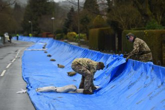 Members of the 4th Battalion Royal Regiment of Scotland erect flood barricades in Ilkley, West Yorkshire, as Storm Dennis sweeps in over the region.