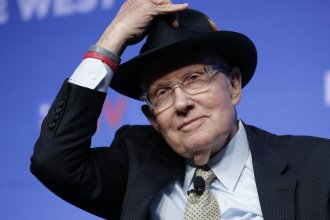 Former U.S. Sen. Harry Reid tips his hat during a November fundraiser for the Nevada Democratic Party in Las Vegas.