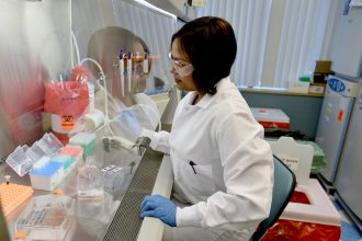 Research & Development associate Divya Nagalati works on cell cultures in Regeneron's infectious disease labs in Tarrytown, N.Y. The firm is looking for tailored antibodies that might prove useful against the new coronavirus.