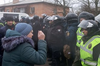 Local residents protest the plans to quarantine evacuees from coronavirus-hit China at a local hospital, in the settlement of Novi Sanzhary, Ukraine, on Thursday.