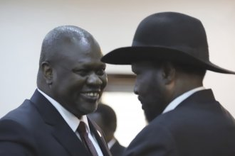 South Sudanese Vice President Riek Machar (left) shares a smile with President Salva Kiir after a swearing-in ceremony Saturday in the capital, Juba. Observers hope their newly forged coalition spells an end to civil war.