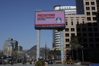 A huge screen displaying precautions against the new coronavirus is seen in downtown Seoul, South Korea, on Sunday.