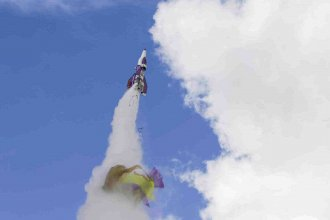 """""""Mad"""" Mike Hughes' rocket takes off with what appears to be a parachute tearing off during its launch near Barstow, Calif. Hughes was killed when the rocket crashed Saturday."""