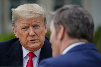 President Trump speaks with anchor Bill Hemmer during a Fox News virtual town hall from the Rose Garden of the White House on Tuesday.
