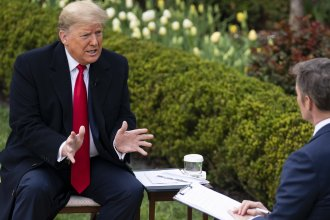 President Donald Trump talks with host Bill Hemmer Tuesday during a Fox News virtual town hall with members of the coronavirus task force at the White House.