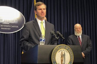 Gov. Andy Beshear discusses developments in Kentucky regarding the new coronavirus in Frankfort, Ky., earlier this month.