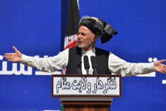 Afghan President Ashraf Ghani speaks earlier this month in Jalalabad. Ghani's dispute with Abdullah Abdullah over election results has been cited as one reason for the delay in organizing prisoner releases with the Taliban, a key stipulation in a peace deal announced last month.