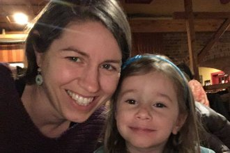 """Avery Hoppa with her 3-year-old daughter Zelda. Hoppa says she's """"incredibly grateful"""" that she and her husband still have jobs. But she says it """"feels weird to be a consumer right now"""" as many are struggling financially."""