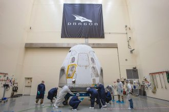The SpaceX Crew Dragon spacecraft is prepared for its first crewed launch from American soil. It arrived at the launch site on Feb. 13.