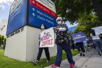 Health care workers protest hospital understaffing and insufficient personal protective equipment last week outside Providence St. Joseph Medical Center in Burbank, Calif.