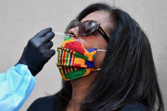 A woman is tested for the coronavirus at Harlem's Abyssinian Baptist Church in New York City.