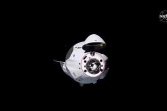 SpaceX's Crew Dragon capsule approaches the International Space Station ahead of docking Sunday.