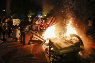 Demonstrators start a fire on Sunday near the White House as they protest the death of George Floyd.