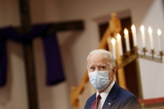 Former Vice President Joe Biden listens Monday as clergy members and community activists speak during a visit to Bethel AME Church in Wilmington, Del.