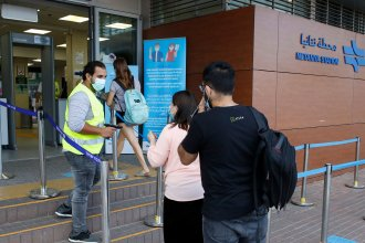 Passengers have their temperature checked before entering a railway station in the Israeli coastal city of Netanya on June 22.