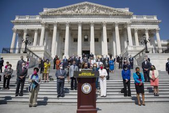 House Speaker Nancy Pelosi of Calif., joined by House Democrats spaced for social distancing, spoke at a press conference on the House East Front Steps of the Capitol ahead of ahead of the House vote on the George Floyd Justice in Policing Act of 2020.