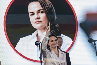 Svetlana Tikhanovskaya, presidential candidate in Belarus elections 2020, makes the symbol of victory in a rally in Minsk.