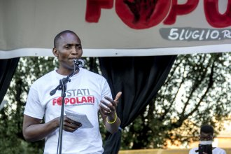 "Aboubakar Soumahoro speaks at a protest in Rome last month. ""If the workers lack dignity and rights, the food they provide is virtually rotten,"" he says in a new short documentary, <em>The Invisibles.</em>"