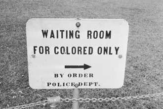 In her new book, <em>Caste, </em>Pulitzer Prize-winning journalist Isabel Wilkerson examines the laws and practices that created what she describes as a bipolar, Black and white caste system in the United States. Above, a sign in Jackson, Miss., in May 1961.
