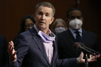 Virginia Gov. Ralph Northam speaks during a news conference in Richmond, Va. on June 4. Virginia has rolled out a smartphone app to automatically notify people if they might have been exposed to the coronavirus.
