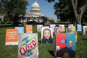 """An installation of children's art is set up outside the Capitol on Wednesday. Kids can develop """"severe"""" symptoms from the coronavirus, the Centers for Disease Control and Prevention said in a report released Friday."""
