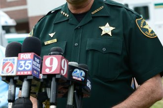 """Marion County Sheriff Billy Woods speaks during a press conference in Ocala, Fla., in 2018. Woods sent an email Tuesday informing the approximately 900 people working in the department that """"when you are on-duty/working as my employee and representing my Office – masks will not be worn,"""" the Ocala<em> Star-Banner</em> reports."""