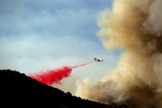 An air tanker drops retardant as the Lake Fire burns in the Angeles National Forest north of Santa Clarita, Calif., on Thursday.