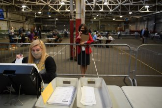 A poll watcher monitors the counting of ballots at the Allegheny County elections warehouse on Nov. 6 in Pittsburgh.