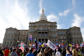 Protestors gather in support of President Trump on Nov. 14 in Lansing, Mich. Trump and his allies have baselessly alleged widespread voter fraud was to blame for the president's election loss.